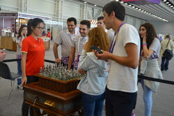 "Hou Yifan, the world chess champion, and visitors of the exhibition played a game on the unique chess set ""Marches on Bosporan""."
