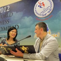 Hou Yifan, Chinese chess player, the holder of three world champion titles among women, the winner of three women's world team chess championships in the linup of PRС national team, and Igor Lobortas.