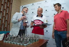 The exclusive presentation of the Marches on Bosporan chess set at the Intourist Baku hotel. Sergey Karyakin, Andrey Filatov and Igor Lobortas are on the photo.
