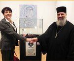 Laura Molteni, the member of House of Representatives (Rome) and hieromonk Ambrose (Milan) next to the world record